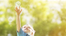 Foster-care-home-Boy-catching-bubble 3